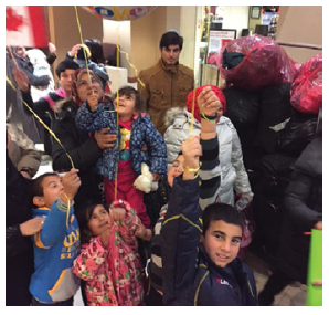 Omidvar and 16 others sponsored this family of 12 from Syria in 2015. This photo was taken when they landed in Canada. (Photo: Compliments of Ratna Omidvar)
