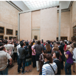 The Louvre Museum, which houses the Mona Lisa (shown here) is among the top tourist attractions in Paris. The small painting attracts crowds every day. (See page 80 for an article on an Ottawa-based Mona Lisa exhibit.) (Photo: Pueri Jason Scott)