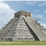 The pyramids and temples of Chichén Itzá in Mexico are a popular tourist site and the iconic Temple of Kukulkan, shown here, has been named one of the New Seven Wonders of the World. (Photo: Daniel Schwen)