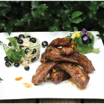 Quick Irresistible Barbecued Ribs make a tasty main course when served with some pretty rice pilaf on the side. (Photo: Larry Dickenson)