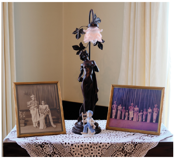The home is full of family treasures, including these wedding photos of the couple. The chest they are on is a family heirloom called a petagama, used to store clothes during the monarchical era. (Photo: Dyanne Wilson)