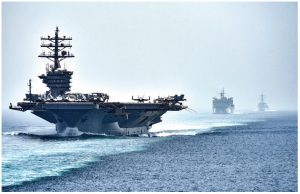 The aircraft carrier USS Dwight D. Eisenhower patrols the Strait of Hormuz, where Iran seized a British oil tanker earlier this year. As the Iran crisis intensifies, we could see a dramatic spike in oil prices, followed by a recession in late 2020. (Photo: Mass Communication Specialist 3rd Class J. Alexander Delgado)