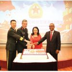 To mark the 92nd anniversary of the founding of the Chinese People's Liberation Army, Col. Junhui Wu and his wife, Hongyan Yang, hosted a reception at the embassy. From left: Wu, Col. Acton Kilby, Department of National Defence, chargé d'affaires Mingjian Chen and MP Chandra Arya participated in the cake-cutting ceremony. (Photo: Tao Lei)