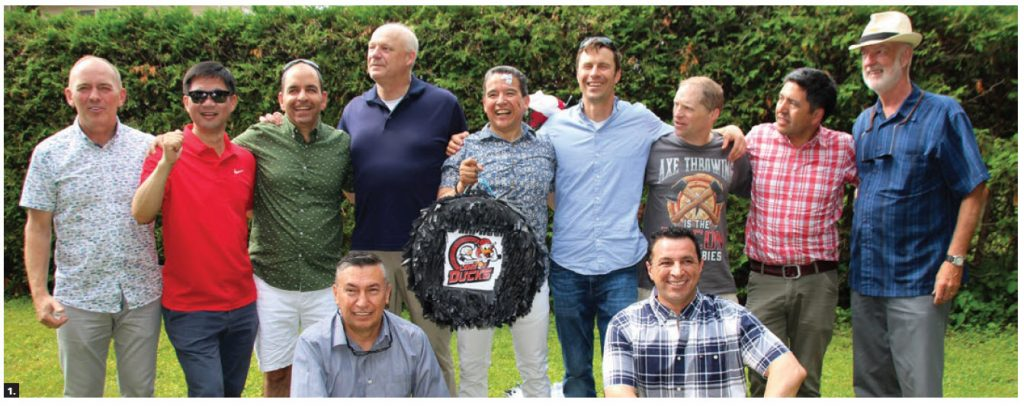 The Ottawa Service Attaché Association's Lame Ducks hockey team members and coaches attended a  birthday party for Mexican defence attaché Pedro Judas Ornelas Cruz. From left back row: Coach Darcy Byrtus, ChangBae Yoon (Korea), Fernando San Martin (Peru), Ton Linssen (Netherlands), Pedro Judas Ornelas Cruz (Mexico), Tony Stibral (U.S.), Rob Worsham (U.S.), Jorge Castillo (Chile) and Denis Rouleau, coach (Canada). Front row: William Cabrera Castro (Colombia) and Eric Zendejas Hinestrosa (Mexico). Ornelas Cruz is holding a piñata in the shape of a hockey puck and the team logo. (Photo: Ülle Baum)