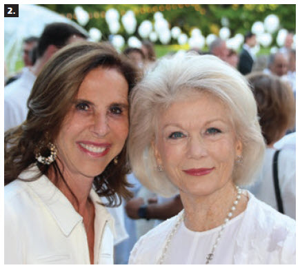 French Ambassador Kareen Rispal hosted a dinner cocktail reception, La Soirée en Blanc, at her residence. She is shown with Adrian Burns, right, chairwoman of the board of the National Arts Centre. (Photo: Ülle Baum)
