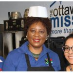 The South African High Commission observed the 2019 International Nelson Mandela Day at the Ottawa Mission by doing volunteer work. High Commissioner Sibongiseni Dlamini Mntambo is flanked by Mayelinne De Lara of the International Public Diplomacy Council, left, and Aneesha Sidhu, manager for volunteer services at the Mission. (Photo: Ülle Baum)
