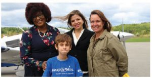 Rio Sarrazin, front, got his wish to fly over the city of Ottawa at the Ottawa Diplomatic Association's Fly Day. He's shown with, from left, South African High Commissioner Sibongiseni Dlamini-Mntambo, Honduran Ambassador Sofia Cerrato and his mom, Melanie Smith. (Photo: Ülle Baum)