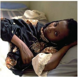 This young Ethiopian woman is suffering from AIDS. Fully 71 per cent of the globe's disease burden from HIV-AIDS, tuberculosis (TB) and malaria falls on sub-Saharan Africa. (Photo: UN Photo/Louise Gubb)