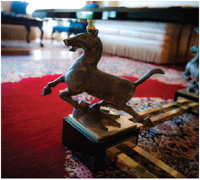 This galloping horse ardorns one of the legs of a coffee table in the main reception room of the residence. (Photo: Ashley Fraser)