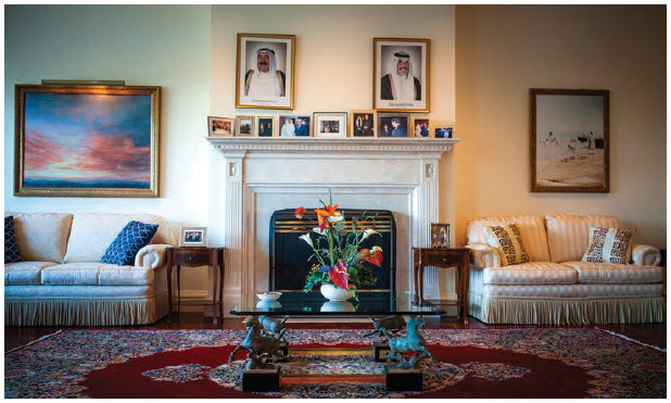 A painting in the large sitting room off the hall, where ochre walls, a fireplace and fringed, cream-coloured sofas blend formality and comfort, shows Kuwait's connection with the water, situated, as it is, at the tip of the Persian Gulf. (Photo: Ashley Fraser)