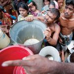 WaterAid says that if a single bucket were to hold all the water in the world, only a teacup if it would be potable and of that, only a teaspoon would be accessible. These residents of Old Dhaka, Bangladesh, are being given water by the military. (Photo: Kibae Park/Sipa Press - UN photo)