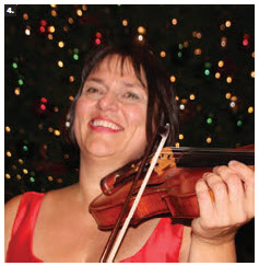 """Spirit of Change,"" an annual classical concert on Parliament Hill, commemorated the 30th anniversary of democratic transformations in Central and Eastern Europe. The event was hosted by MP Chandra Arya and supported by the embassies of Bulgaria, Latvia, North Macedonia, Poland and Slovakia. Violinist Ralitsa Tcholakova, pictured here, performed. (Photo: Ülle Baum)"