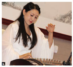 "Tong Zhang, wife of Chinese Ambassador Peiwu Cong, hosted a  ""cultural salon on winter treats,"" featuring a concert with national instruments as well as martial arts demonstrations and a cooking show. This musician performed on a Chinese zither, which dates back 2,500 years. (Photo: Ülle Baum)"