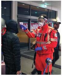 Public health officials administer temperature checks at an airport in Bologna, Italy. (Photo: Dipartimento Protezione Civile from Italia)
