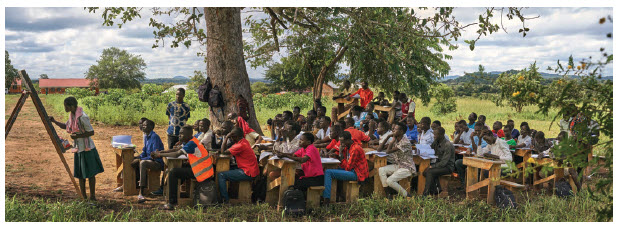 """Education is still closed in Uganda. This overcrowded """"classroom"""" shows the problem with reopening schools. (Photo: war child Canada)"""