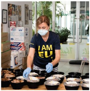 Caridad Vicen Enguita, assistant to the EU ambassador, helps package meals for Food for Thought as part of the embassy's unique way to celebrate Europe Day. (Photo: Presantha Dassa)