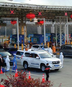 """""""Epidemic prevention"""" measures at Qujiang Toll Station in Yanta District, Xi'an, are shown here. The first cases of COVID-19 were reported in Wuhan, China. (Photo: Liuxingy)"""