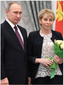 """Elizaveta Glinka, shown here with Russian President Vladimir Putin, was known as  """"Dr. Liza."""" She was a medical professional who reintroduced the notion of charitable acts to a populace that had relied on the state for its needs over decades. Her story ended tragically, however. (Photo: Kremlin.ru)"""
