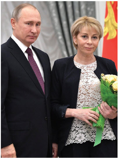 "Elizaveta Glinka, shown here with Russian President Vladimir Putin, was known as  ""Dr. Liza."" She was a medical professional who reintroduced the notion of charitable acts to a populace that had relied on the state for its needs over decades. Her story ended tragically, however. (Photo: Kremlin.ru)"