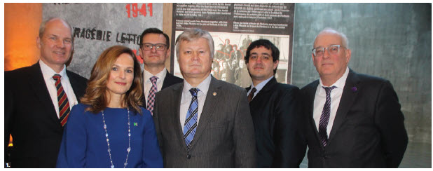 "Latvian Ambassador Karlis Eihenbaums hosted the opening of the exhibition ""The Latvian Tragedy 1941"" at the Canadian War Museum. From left: Jeff Mierins, Latvian-Canadian entrepreneur and president and founder of ColdWarCollection.com; Caroline Dromaguet, acting director-general of the Canadian War Museum; Janis Garisons, state secretary of the Ministry of Defence of Latvia; Ambassador Eihenbaums; Ilya Lensky, director of the Latvian museum, Jews in Latvia; and Robert Austin, associate director of the Centre for European, Russian and Eurasian Studies at the University of Toronto's Munk School of Global Affairs and Public Policy. (Photo: Ülle Baum)"