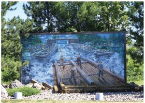"Pembroke has an outdoor art gallery. Known as the Pembroke Heritage Murals, there are 30 of them, painted by artists of local and national renown and depicting the history of the area. (Photo: ""The Timber Raft"" artist Pierre Hardy, 2004, Pembroke Heritage Murals © since 1989"")"
