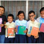 Students at SchoolBOX partner schools receive school supplies every year. These packages are important — they can mean the difference between going to school and dropping out. (Photo: courtesy of schoolbox)