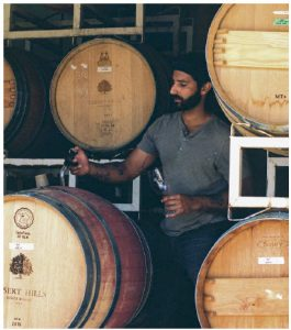 Rajen Toor, winemaker at Ursa Major in B.C.'s South Okanagan, has grown up surrounded by vines. His family has been farming the Black Sage Bench region for the past 25 years. One of his wines is pictured below. (Photo: Ryan Grifone )