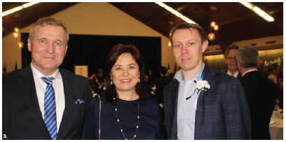 Estonian Ambassador Toomas Lukk attended Estonia's 102nd Independence Day celebration at Toronto's Estonian House. From left: Lukk, his wife, Piret, and Veiko Parming, president of Estonian House, stand in the grand hall. (Photo: Ülle Baum)