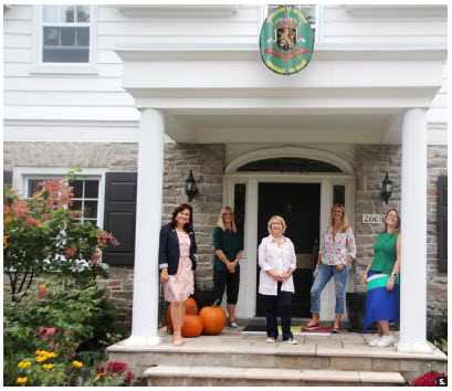 Shown standing in front of the Belgian ambassador's residence are HOMSA Europe Group executive team members Piret Lukk, Jenni Ahlin, Victoria Carol Eriksson, Kathleen Billen and Dorota Skuseviciene. They prepared 75 welcome bags with European treats and delivered them to HOMSA members across the city. (Photo: Ülle Baum)