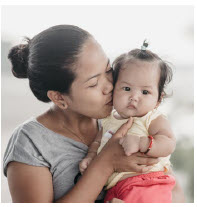 This mother and child in the Philippines benefit from Nutrition International's programs. (Photo: nutrition international)