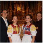 Sabina Koziakova, centre left, and Terezia Koziakova, centre right, daughters of Slovakian Ambassador Vit Koziak, far left, performed Jasna hviezdicka, a Slovakian Christmas carol. The girls are wearing handmade folk costumes and their mother, Terezia, is at right. (Photo: Sabina Koziakova, centre left, and Terezia Koziakova, centre right, daughters of Slovakian Ambassador Vit Koziak, far left, performed Jasna hviezdicka, a Slovakian Christmas carol. The girls are wearing handmade folk costumes and their mother, Terezia, is at right. (Photo: Ülle Baum)