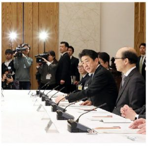 Japanese officials and experts, shown here at their first pandemic meeting in February 2020, have helped keep COVID-19 at bay, thanks to a cluster-based approach to tracking infections. (Photo:  Japanese Cabinet Secretariat)