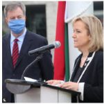 To mark the national day of Hungary and commemorate the Hungarian Revolution and Freedom Fight of 1956, Ambassador Maria Eva Vass-Salazar held a flag-raising ceremony at City Hall. She's shown with Ottawa Mayor Jim Watson. (Photo: Ülle Baum)