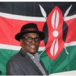 Kenyan High Commissioner John Lepi Lanyasunya celebrated Kenya's independence day virtually. Here the ambassador stands in front of the national flag. (Photo: Ülle Baum)