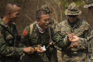 U.S. Marine 1st Lt. Mark Caldwell shares a meal with a Royal Thai Marine during exercise Cobra Gold 2020 in Thailand in March 2020. (Photo: U.S. Marine Corps photo by Staff Sgt. Jordan E. Gilbert)
