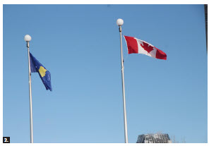 Kosovo Independence Day marks Kosovo's declaration of independence in 2008. In celebration of the 13th such day, Ambassador Adriatik Kryeziu hosted a flag-raising ceremony in front of Ottawa City Hall. The Kosovar flag is shown here, next to the Canadian flag. (Photo: Ülle Baum)