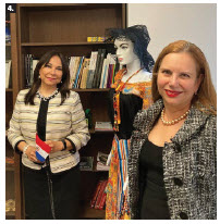 Paraguayan Ambassador Ines Martinez Valinotti, left, received book donations from Mayelinne De Lara, general director of the International Public Diplomacy Council at The Hague on the occasion of the inauguration of the library at the Paraguayan Embassy. (Photo: Ülle Baum)