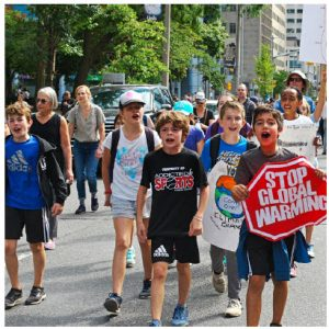 Children march down University Avenue in Toronto as part of the Global Strike for Climate Justice. Bill Gates's new book outlines how hard it is to address this monstrous problem.