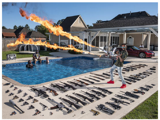 Spectacular moments in photojournalism, including a former U.S. Marine at home with his gun collection, make up the World Press Photo of the Year exhibition at the Canadian War Museum. (Photo: Canadian War Museum/World Press Photo)
