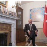 Turkey's ambassador to Canada, Kerim Uras, poses in Take Your Seat's chair following its latest Turkish expedition.
