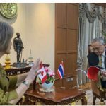 Sarah Taylor, Canada's ambassador to Thailand, Cambodia and Laos, shares a moment and her Take Your Seat book with the deputy prime minister and minister of foreign affairs of Thailand, Don Pramudvwinai.