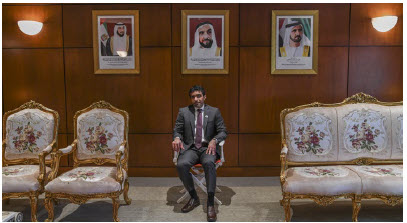 Fahad Saeed Al Raqbani, the UAE's ambassador to Canada, takes his seat before Take Your Seat's National Day exhibition.